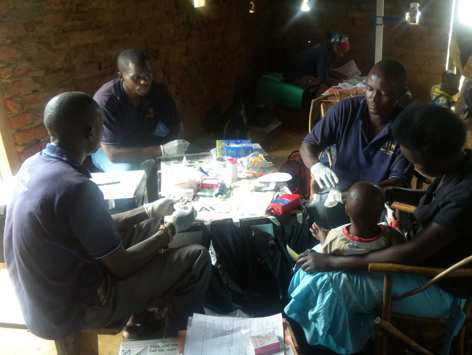 Blood samples being taken from a mother and child from Bukoba Village, Uganda