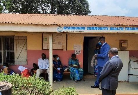 MoH officials interacting with patients in the waiting area