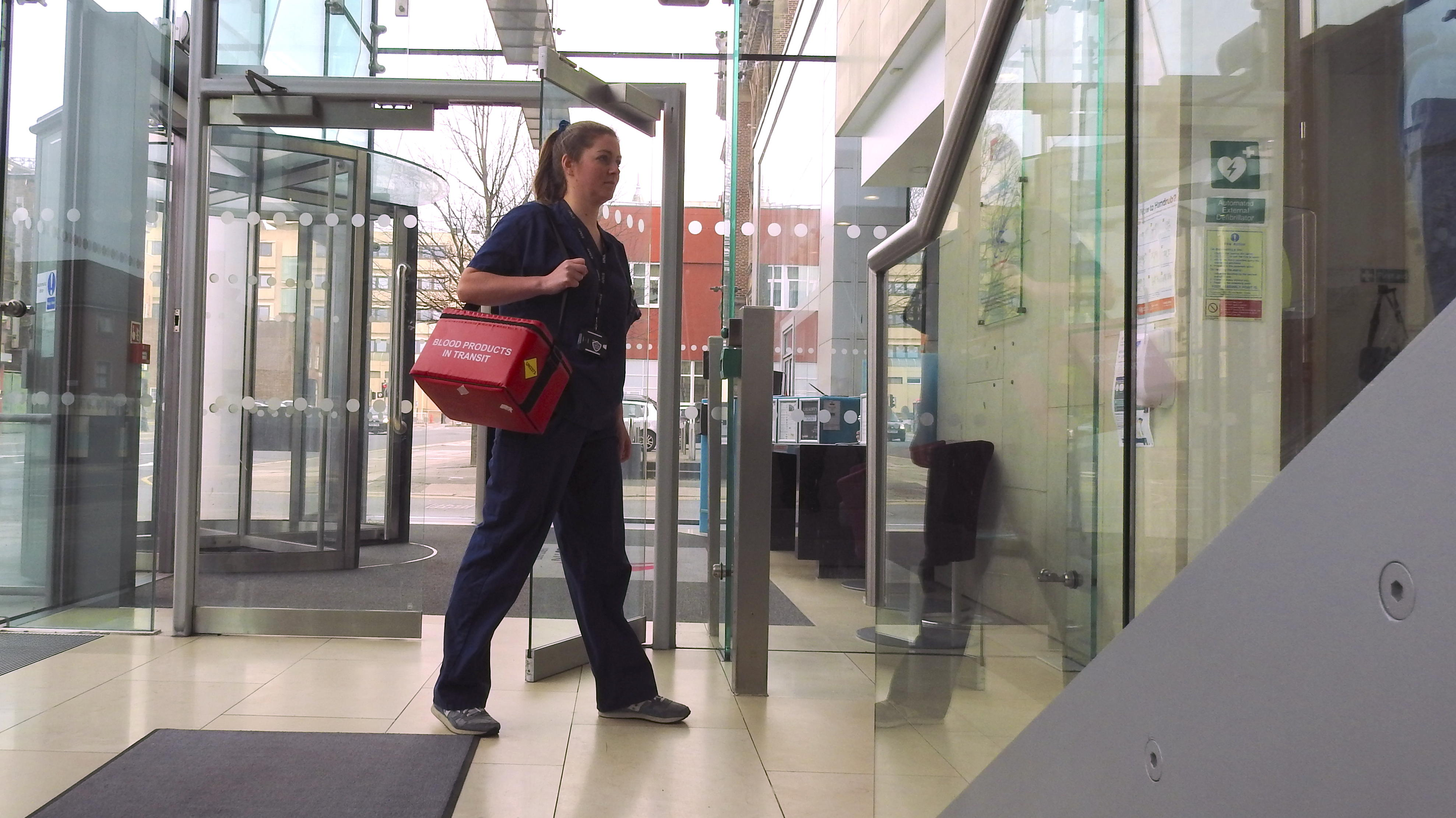 Research nurse arriving at CTID to transfer study samples to the laboratory